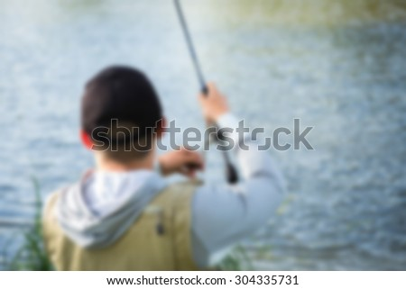 Fishing on the river. blurred Background - stock photo