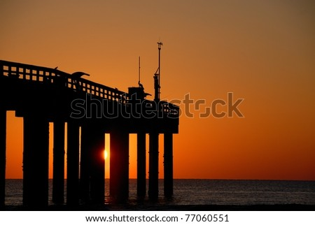 fishing pier at sunrise st. augustine beach florida usa - stock photo