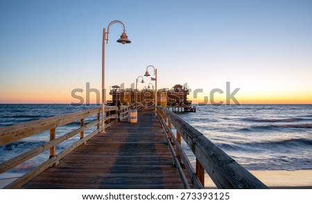 Fishing pier located in the Oceanview area of Norfolk Virginia on the Chesapeake Bay at sunrise - stock photo