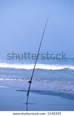 Fishing pole in surf
