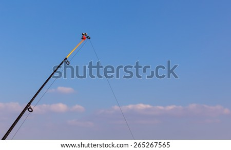 Fishing Pole Tip on blue sky - stock photo