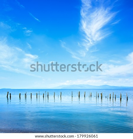 Fishing poles and soft water on a quiet ocean landscape. - stock photo