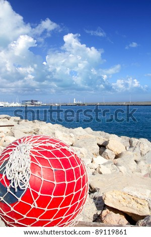 fishing red buoy with net in formentera port breakwater of Mediterranean sea
