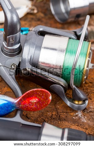 fishing reel with line on natural background