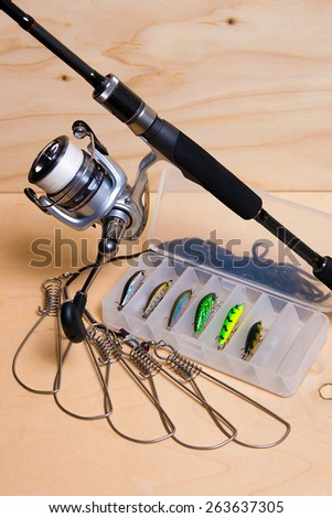Fishing rod and reel with box for baits. Fish stringer. - stock photo