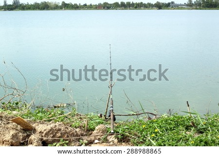 Fishing rod in a lakeside    - stock photo
