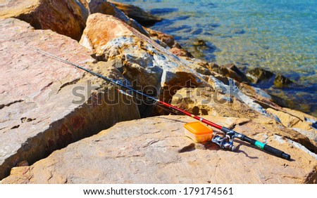 Fishing rod in rock - stock photo