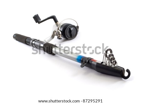 Fishing rod packed for transportation, isolated on white. - stock photo