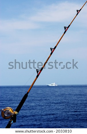 Fishing rod with boat in the background