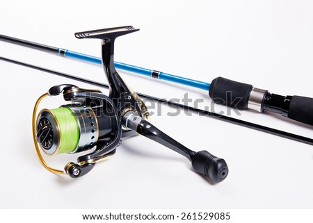 Fishing rod with fishing reel isolated on white - stock photo