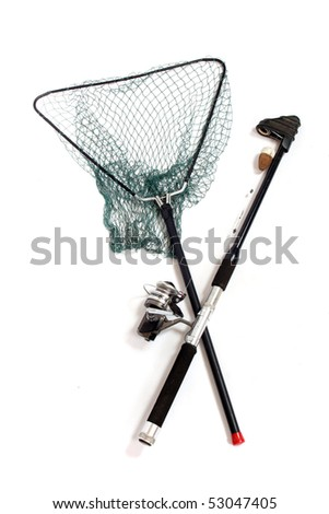 Fishing rod with reels and landing net. - stock photo