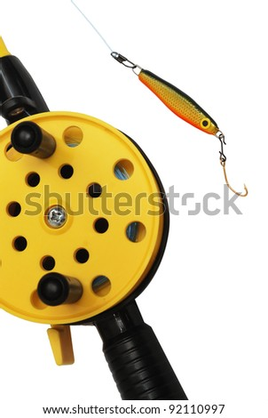 fishing rod with yellow reel  on the white - stock photo
