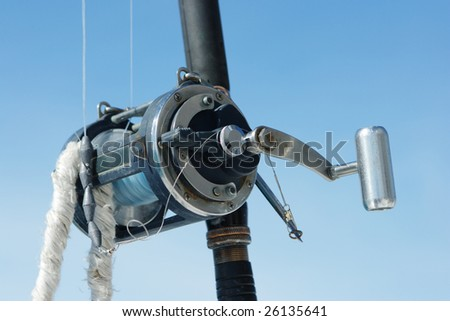 Fishing rods on background of sky - stock photo