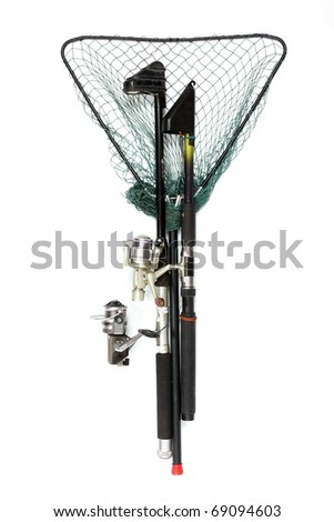 Fishing rods with reels and landing net. - stock photo