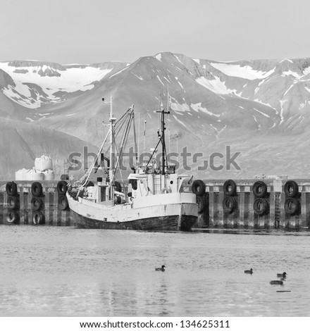 Fishing schooner in the port of Reykjavik city, Iceland (black and white) - stock photo