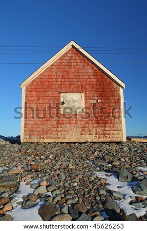 Fishing shack closed for the winter. - stock photo