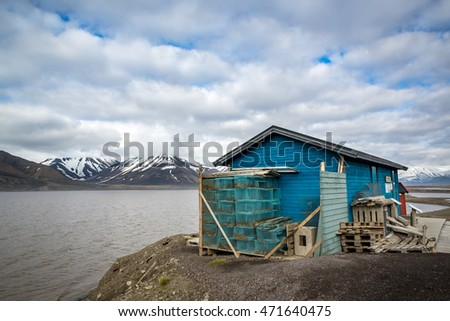 Fishing shack next to bay in Longyearbyen, Svalbard, Spitzbergen