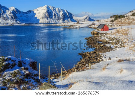 fishing shed near the fjord - stock photo