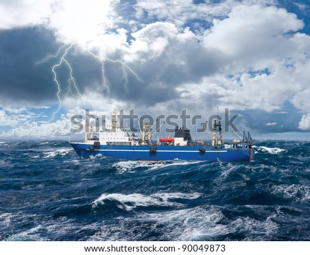 Fishing ship in strong storm sea - stock photo
