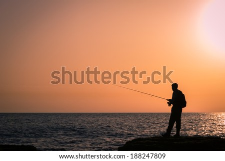 Fishing silhouette at dawn