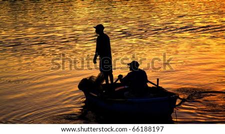 fishing & sunset - stock photo