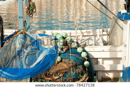 Fishing tackle aboard a trawler waiting for the fishermen - stock photo