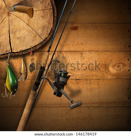 Fishing Tackle Background / Wooden background with fishing tackle and knife - stock photo