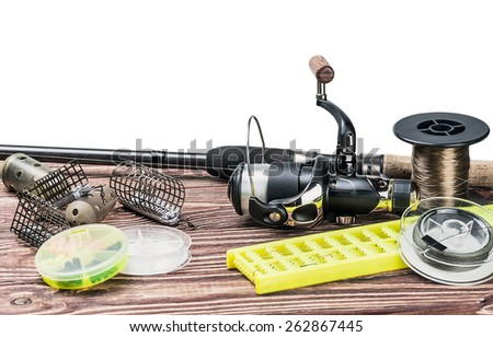 fishing tackle on a wooden table isolated on a white background - stock photo
