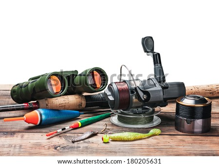 fishing tackle on the table isolated on white background - stock photo