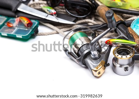 fishing tackles and anchor with cord on white background
