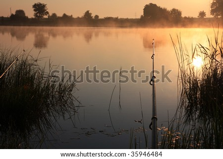 fishing time... two rods and lake - sunrise
