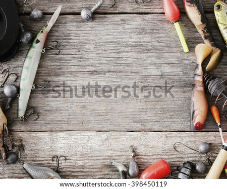 Fishing tools and accessories on the table - stock photo