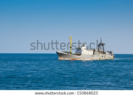 fishing trawler floating in the sea - stock photo