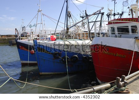 Fishing trawlers moored in the harbor of Elie, Fife, Scotland - stock photo