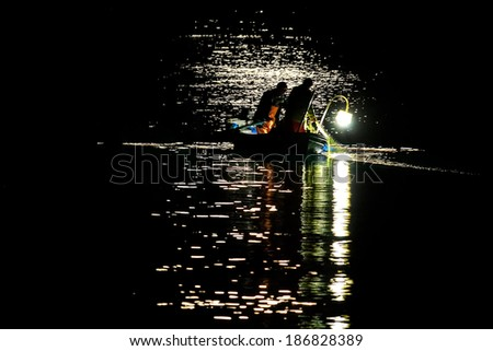 Fishing under the moon light, in Syros island, Greece - stock photo