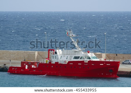 Fishing Vessel.  Fishing boat anchored and the pier. - stock photo