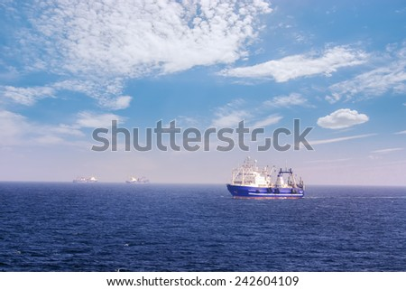 Fishing vessel for fishing in the sea. A Sunny day. Calm weather. Several ships. - stock photo