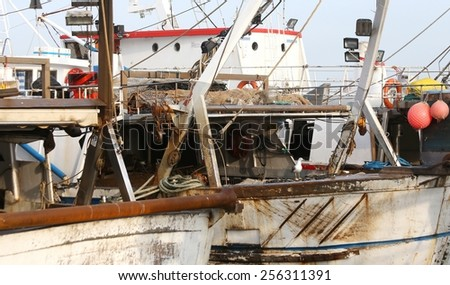 Fishing vessels in sea harbor moored in Italy - stock photo