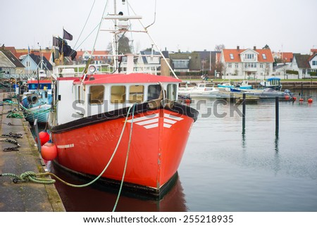 fishing vessels stand in the harbor in Sweden - stock photo