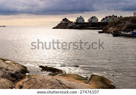 Fishing village at the rocky coast - stock photo