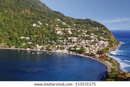 Fishing village in Dominica, Caribbean Islands Scotts Head Dominica is a fishing village in Domica, Caribbean Island. It is the meeting point of Atlantic Ocean and the Caribbean Sea (Soufriere Bay). - stock photo