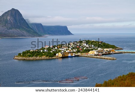 Fishing village of Husoy (House island) is on a small island in area Senja,  Norway.  - stock photo