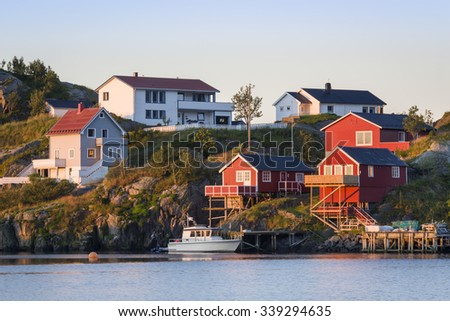 Fishing village on Hamnoy, Lofoten islands, Norway with typical colorful wooden buildings - stock photo