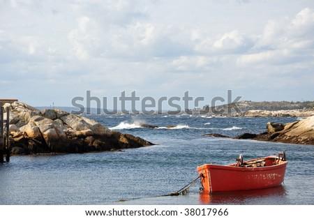 Fishing village scene with boat, Peggy's Cove, Nova Scotia - stock photo