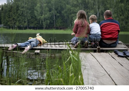 fishing with dad. Three kids are fishing with dad - stock photo