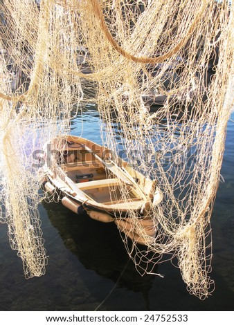 Fishnet and boat. Camogli, Italy - stock photo