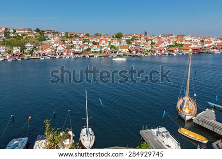 Fiskebackskil with sailboats at the jetty on swedish west coast - stock photo