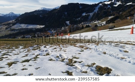 FISS - AUSTRIA - DECEMBER 2014: no snow in Fiss - closed ski slope - stock photo