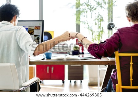 Fist Bump Colleagues Collaboration Teamwork Concept - stock photo