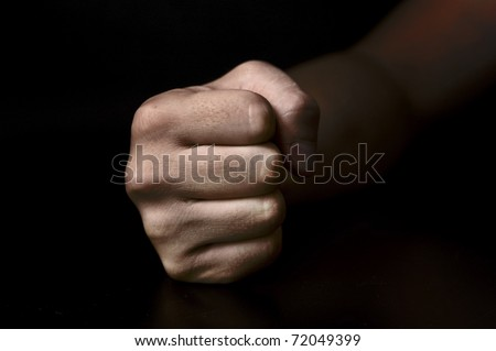 fist isolated on black background